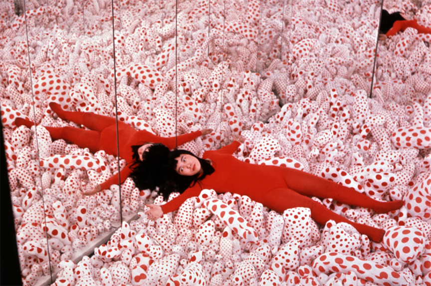 Yayoi shown here in her installation: Phalli's field 1965
